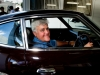 Comedian Jay Leno sits in a 1971 Fairlady 240Z at the Nissan Car Heritage Warehouse.