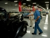 Comedian Jay Leno, right, takes a tour of the Nissan Car Heritage Warehouse with CCO Shiro Nakamura.